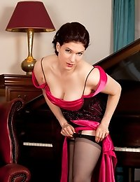 Classy milf in a gown strips down to her hot black lingerie