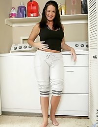 Long haired brunette milf looking gorgeous in the laundry room