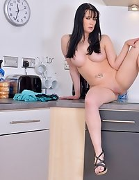 Beautiful milf plays with her creamy pussy while making dinner