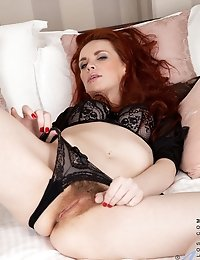 Mystique satisfies her cream filled hairy pussy with a vibrator