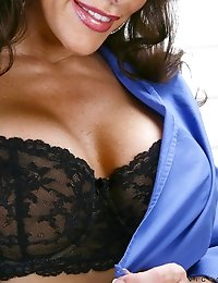 Busty mature Anilos Victoria Valentino sensually peels back her black bra straps one by one