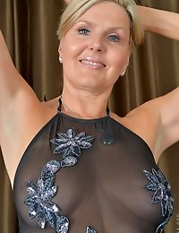 Horny MILF teases in her sheer black lingerie