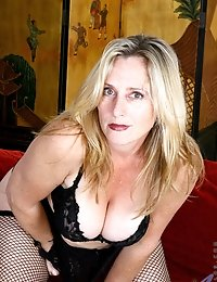 Busty cougar Jordan teasingly shows off her tempting cleavage in her sheer fishnet lingerie