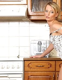 Beautiful Anilos Daniela shows off her matching camisole and panty set in the kitchen