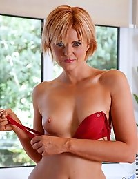 Horny cougar Rebecca spreads her ass apart as she dips a finger in her sweet pink pussy