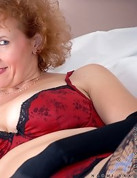 Curly redhead milf posing in her sexy devil red lingerie