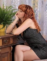 Cougar Katia strips out of her office attire and flaunts her sultry milf body
