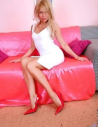 Horny cougar Olga shows off her amazing milf body on the sofa