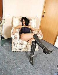 Dark haired anilos beauty dons a sexy corset and knee high hooker boots as she shows off her natural sexiness
