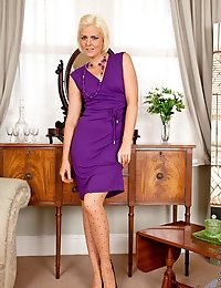 Attractive cougar Rebecca shows off her sexy legs in designer pantyhose