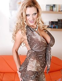 Blonde Anilos Sharon Pink grasps her massive tits and flaunts her tempting cleavage
