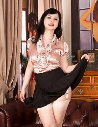 Sultry milf wears full back panties and thigh high stockings under her skirt