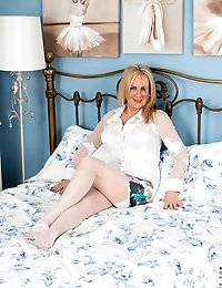 Big tit mommy shows off her legs in her white stockings