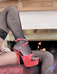 Voluptuous mature woman shows off her curvaceous body in fishnets and high heels