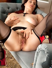 Sexy milf spreads her creamy hairy twat for your viewing pleasure