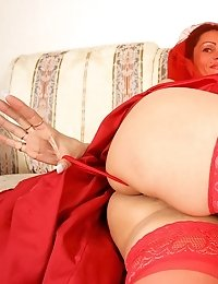 Mature milf nelli could raise the devils cock with her red bridal gown and satin thong