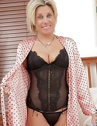 Milf relaxes in bed with super hot lingerie and a thong on