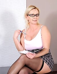 Seductive milf Kimi wearing glasses teases us in her short skirt